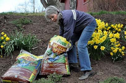 Applying Preen Mulch Plus with weed preventers in the spring