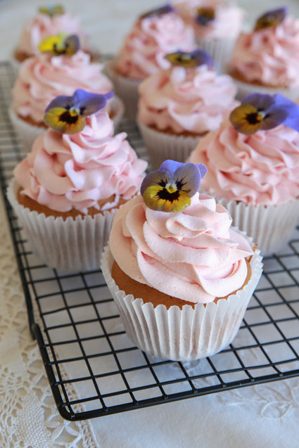 Top a cupcake with fresh pansies