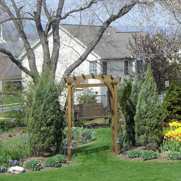Tulips, hyacinths, and grape hyacinths add color to this garden in spring.